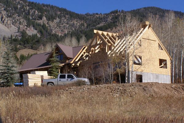 Structural Insulated Panels for a Hybrid Log Home Roof